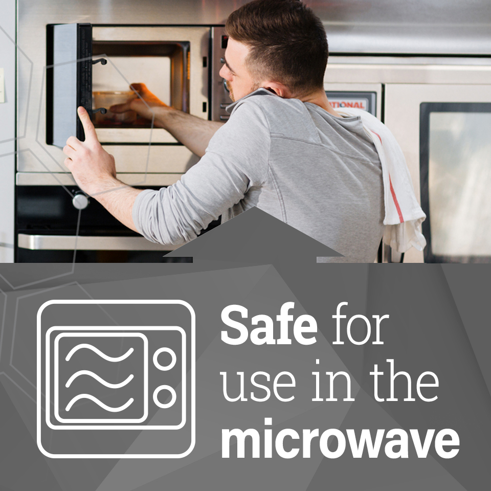 man reaching into a microwave